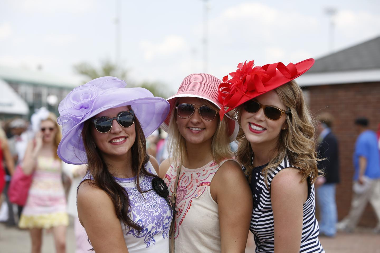 3 cute young girls with hats