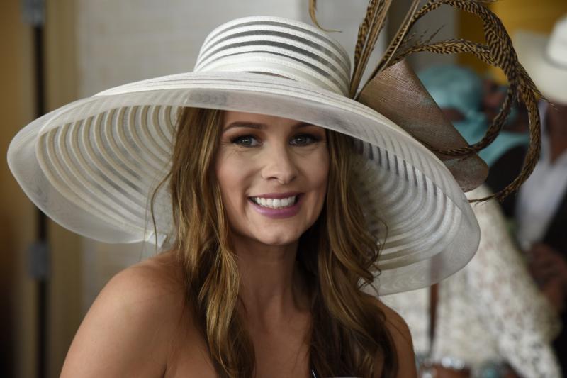 girl in hat smiling
