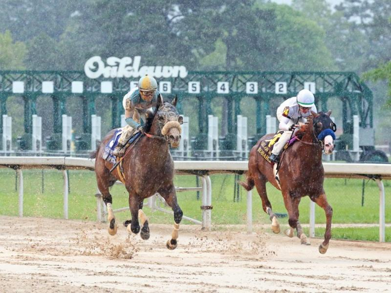 Tom's d'Etat mowed down Improbable in the Oaklawn Mile (Coady Photography)